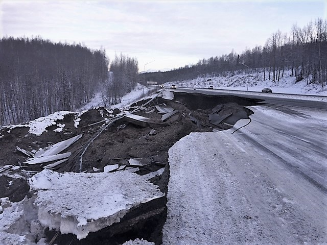 Earth quake damage to the Glenn Highway at Mirror Lake.