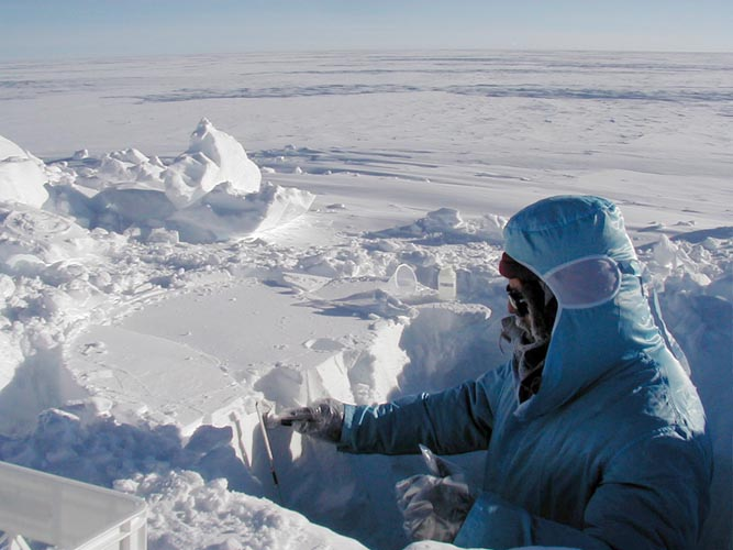 UNH Researcher taking samples in the Arctic