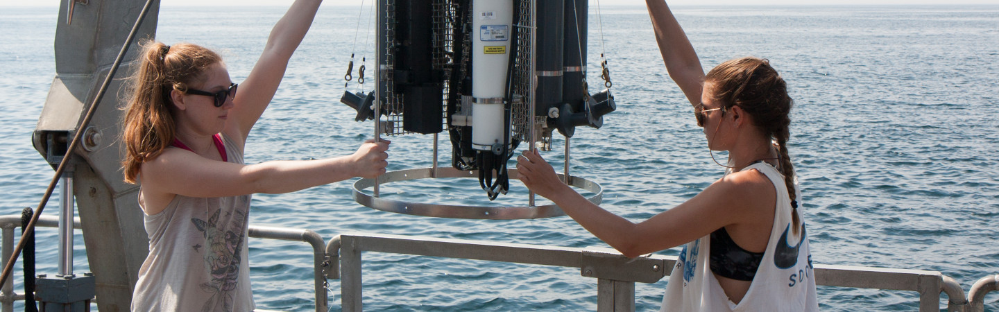 smsoe students working with equipment at sea