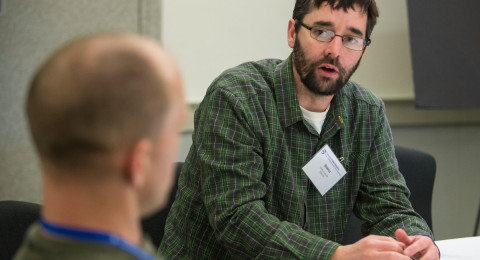 Two participants talk at the School of Marine Science and Ocean Engineering Graduate Research Symposium.