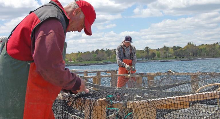 fishermen repairing nets